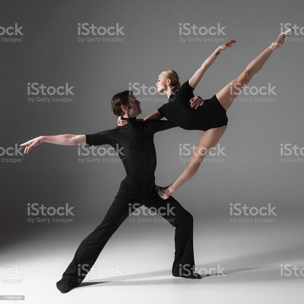 two young modern ballet dancers on gray studio background stock photo