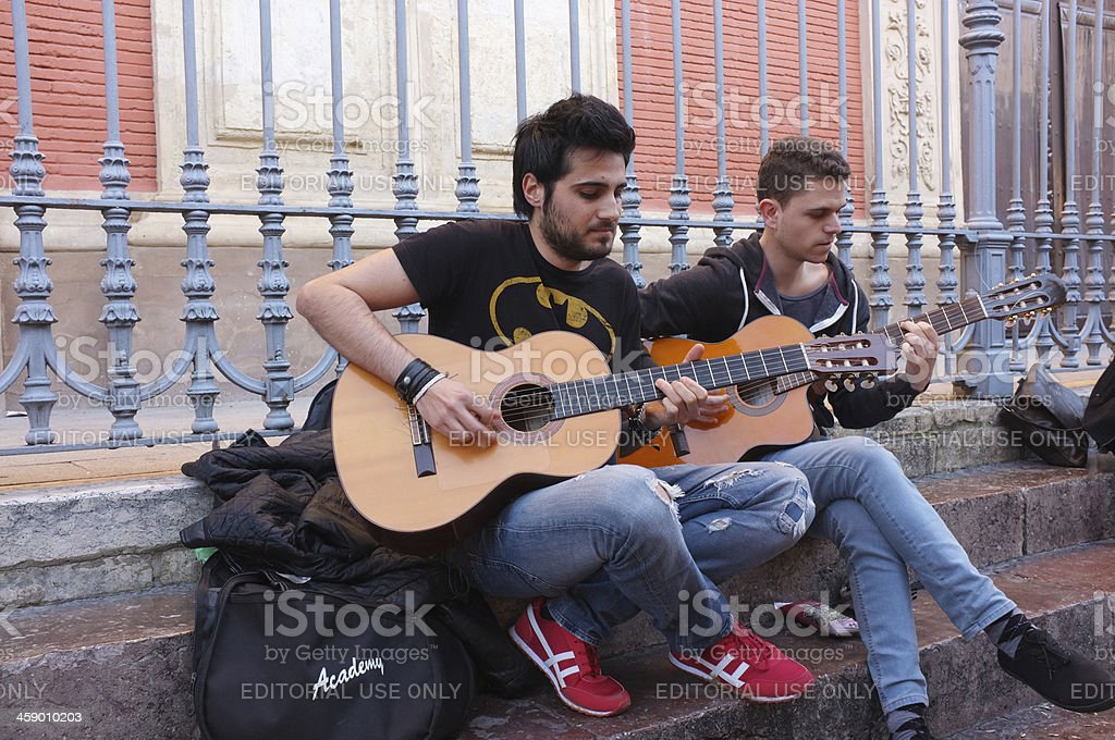 Two young musicians playing on the street in Seville Spain royalty-free stock photo