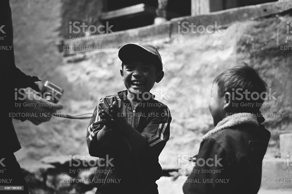 Two Young Nepalese Boys Play royalty-free stock photo