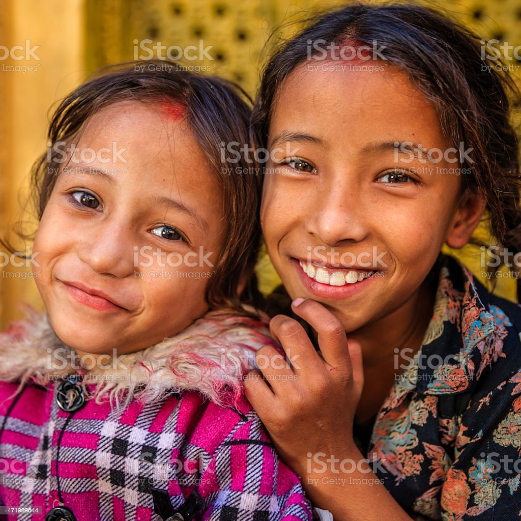 Two young Nepali girls in one of Bhaktapur's temples stock photo