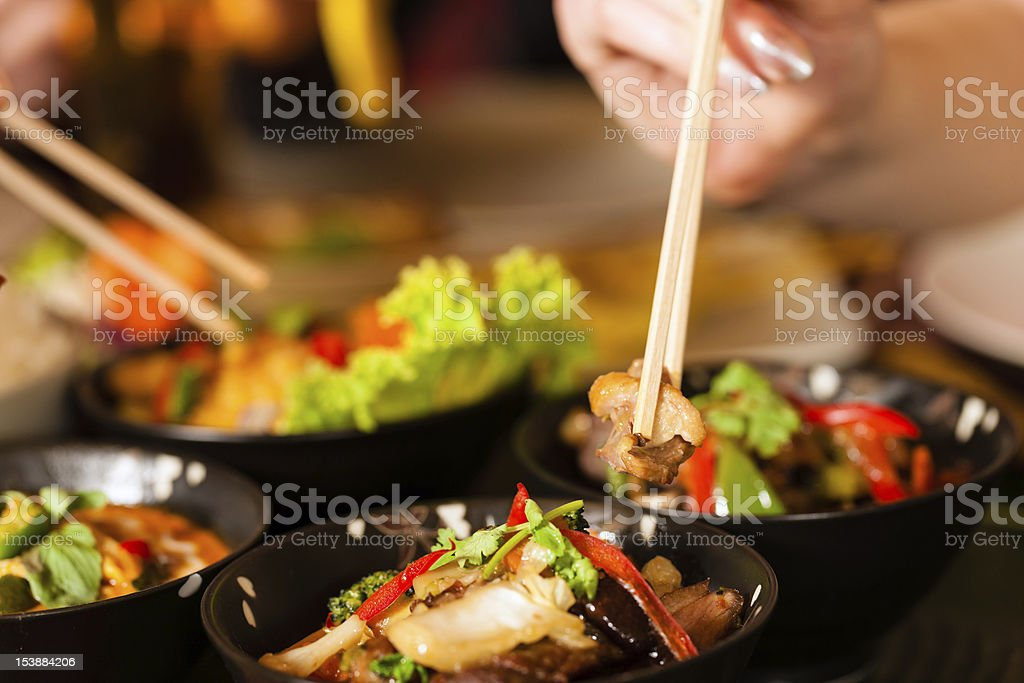 Two young people eating in a Thai restaurant  stock photo