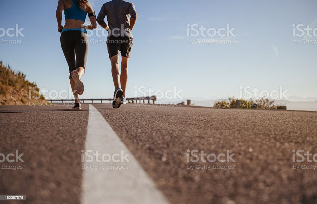 Two young people on morning run stock photo