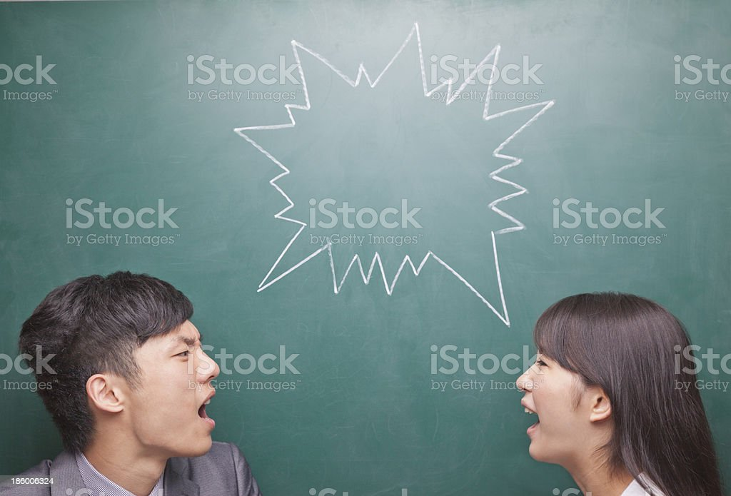 Two young people yelling at each other royalty-free stock photo