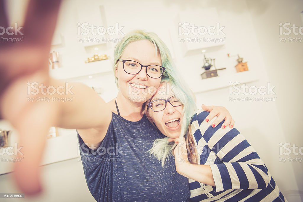 Two Young Pretty Women Taking Selfie Caffe Trieste, Europe stock photo