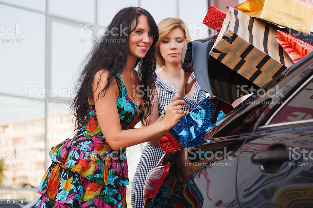 Two young shoppers on a car parking royalty-free stock photo
