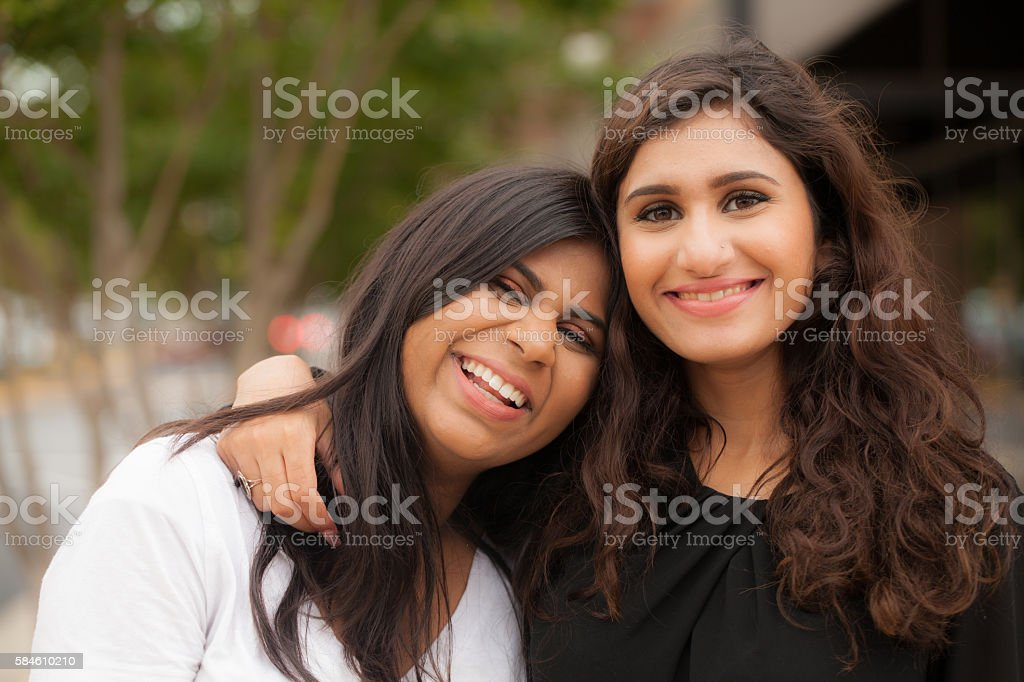 Two young sisters of South Asian ethnicity stock photo