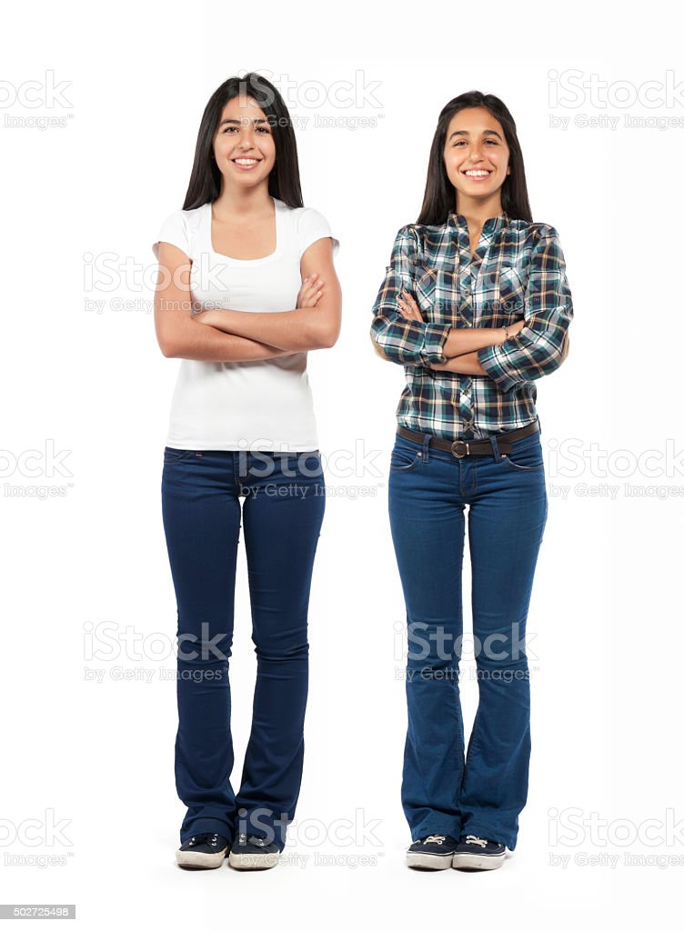 Two young smiling girls isolated stock photo