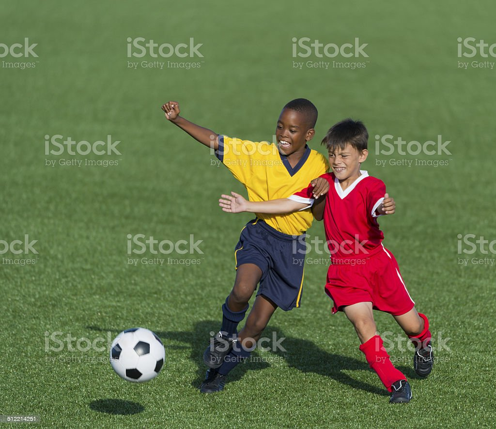 Two Young Soccer Players In Action stock photo
