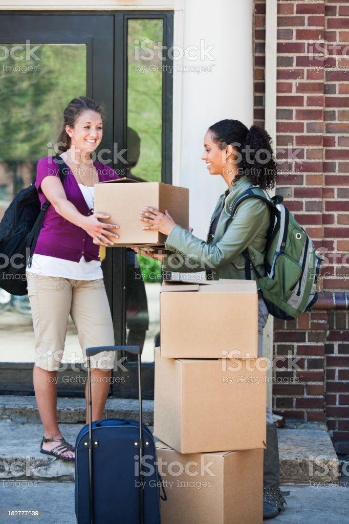 Two Young Student Friends Moving Belongings into College Dorm royalty-free stock photo
