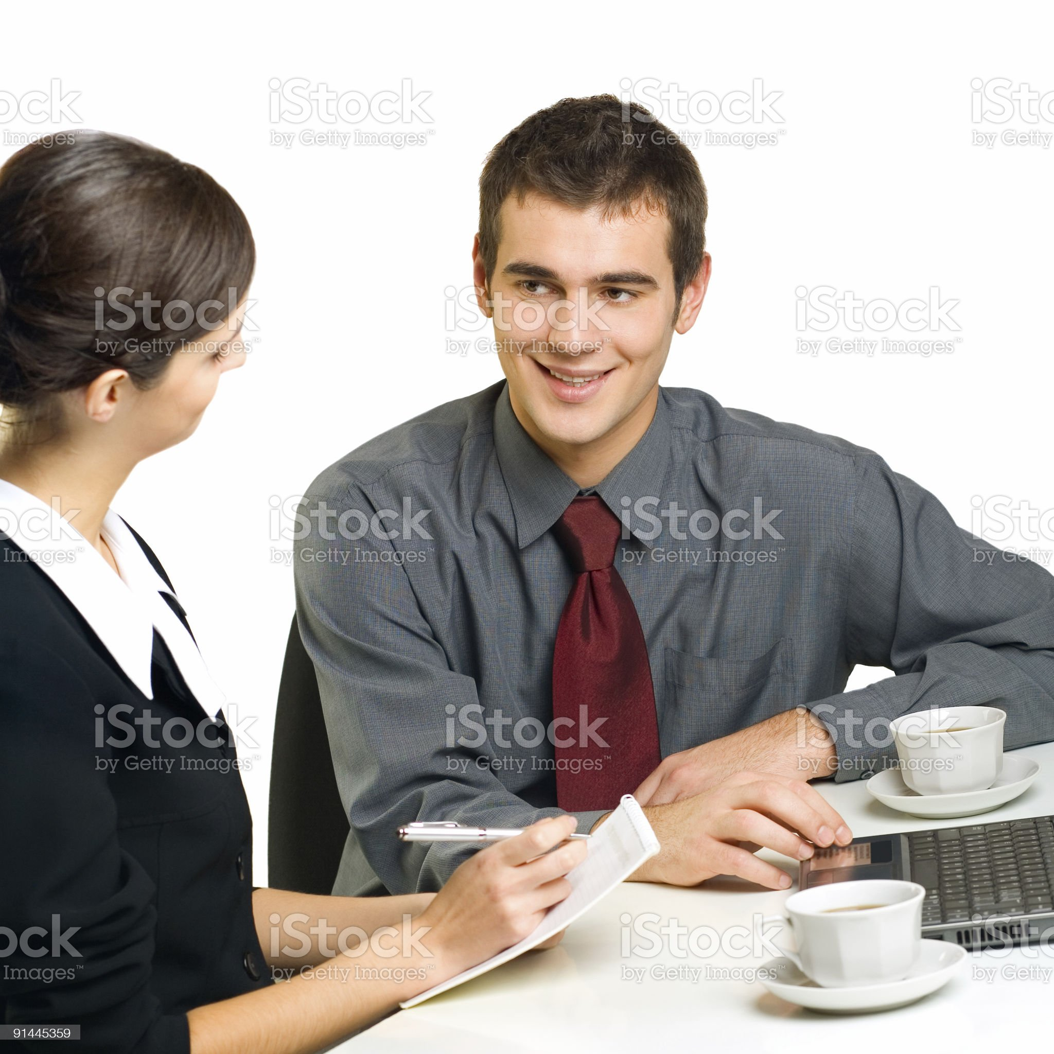 Two young successful businesspeople working at office, isolated on white royalty-free stock photo