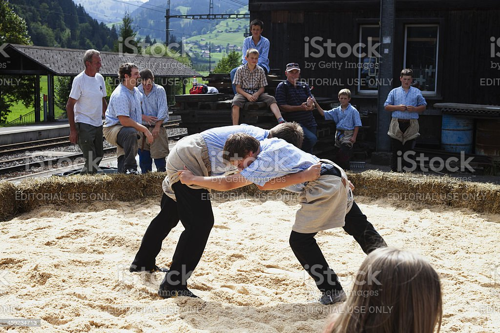 Two young teenagers begin a wrestling match, Boltigen, Simmental stock photo
