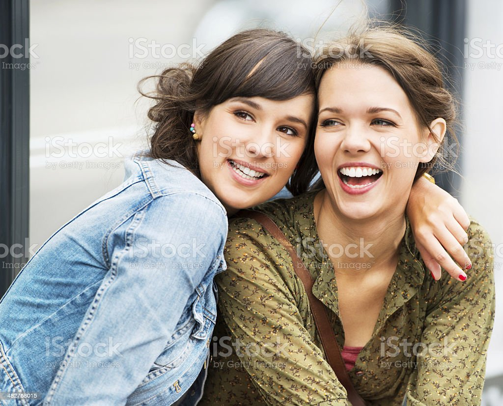 Two young teenagers waiting at the bus stop. royalty-free stock photo