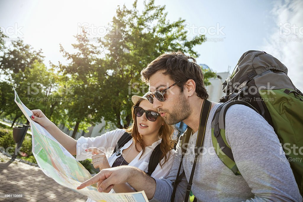 Two young tourists looking at a map stock photo