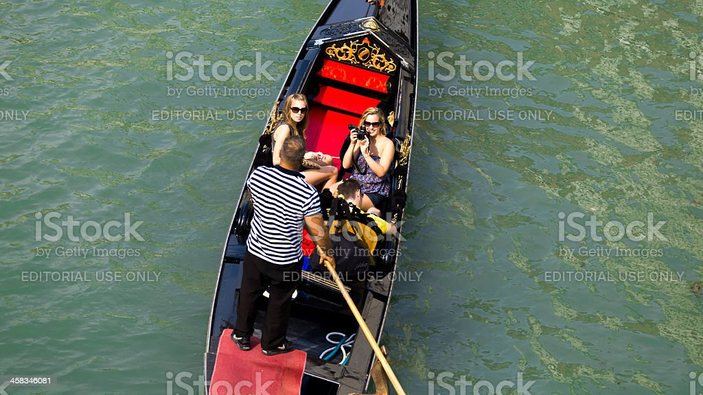 Two young tourists make photo from gondola stock photo
