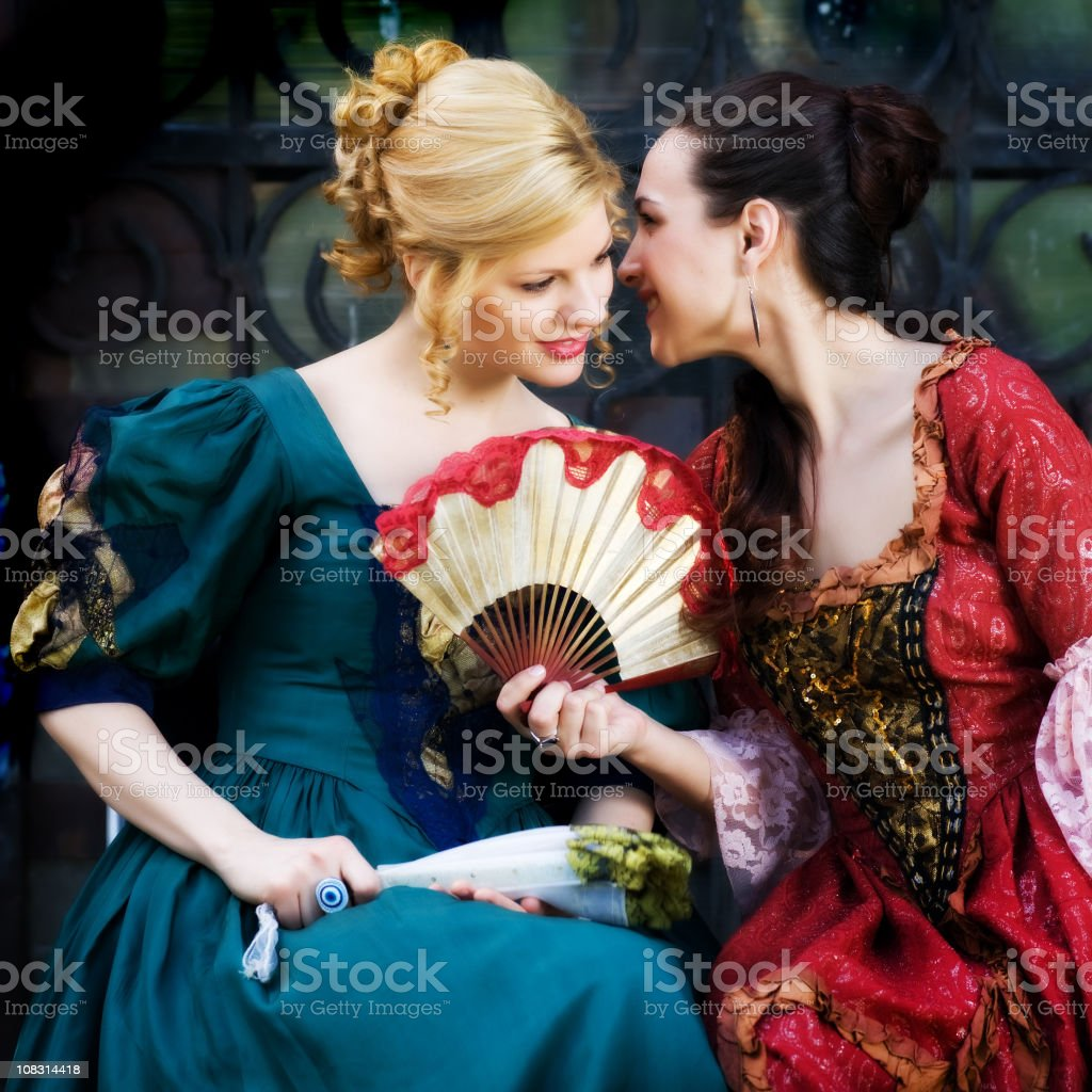 Two young woman  in retro costume  heaving fun outdoor royalty-free stock photo