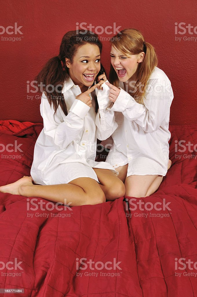 Two young woman laughing on the phone royalty-free stock photo