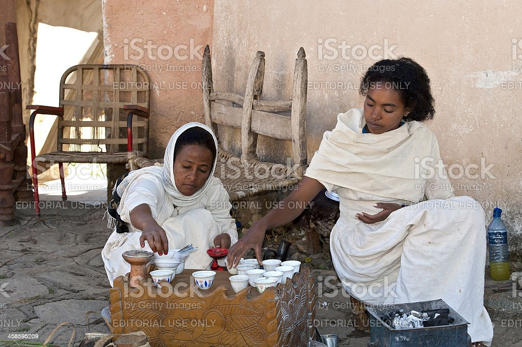 Two young woman preparing a traditional coffee ceremony, Ethiopia stock photo