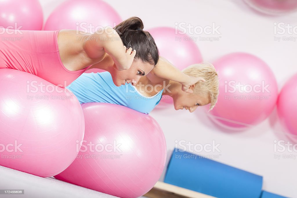 two young woman´s doing exercise royalty-free stock photo