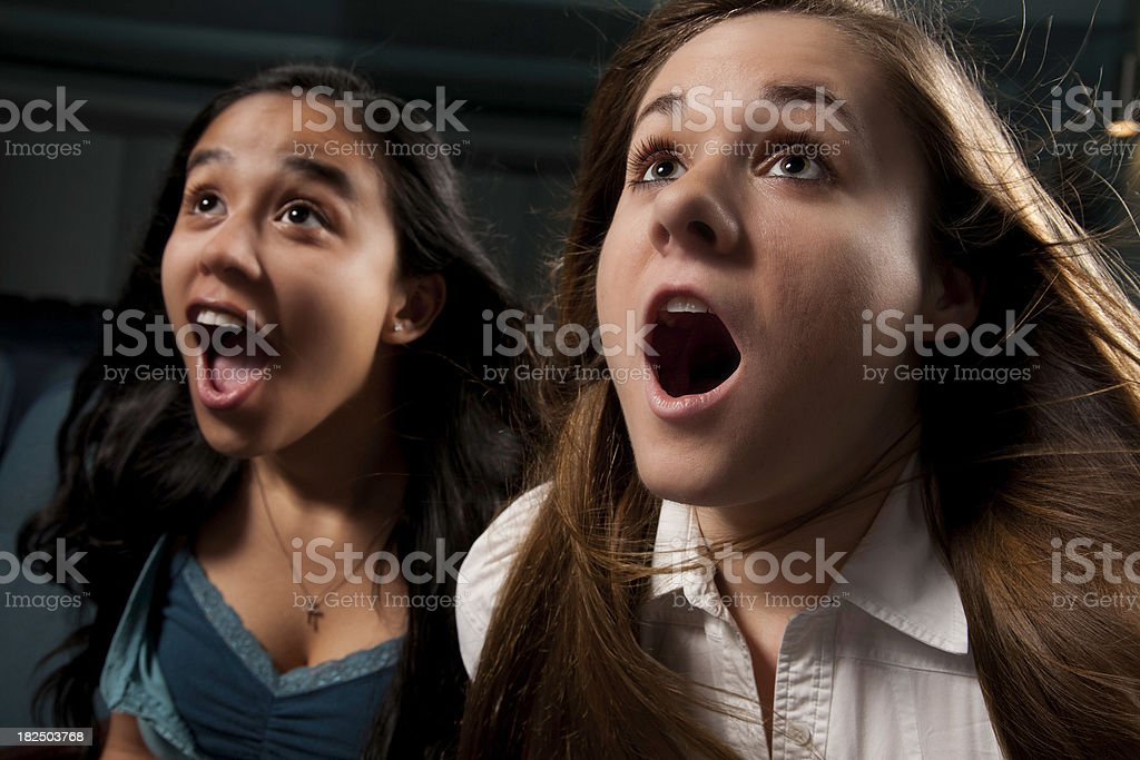 Two Young Women Being Blown Away at the Movies royalty-free stock photo