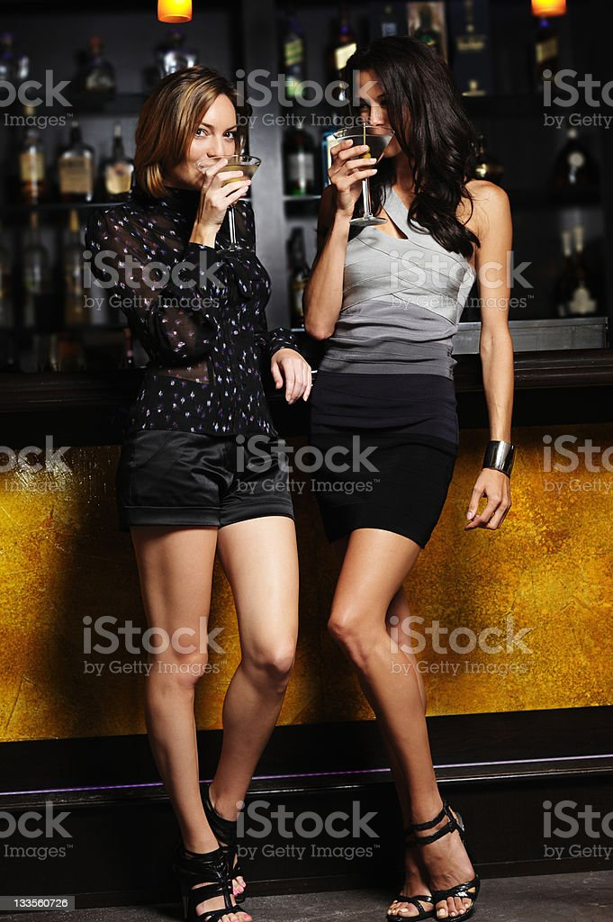 Two Young Women Drinking Martinis in Bar royalty-free stock photo