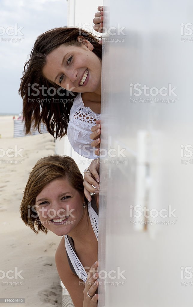 two young women have fun on the beach in Holland stock photo