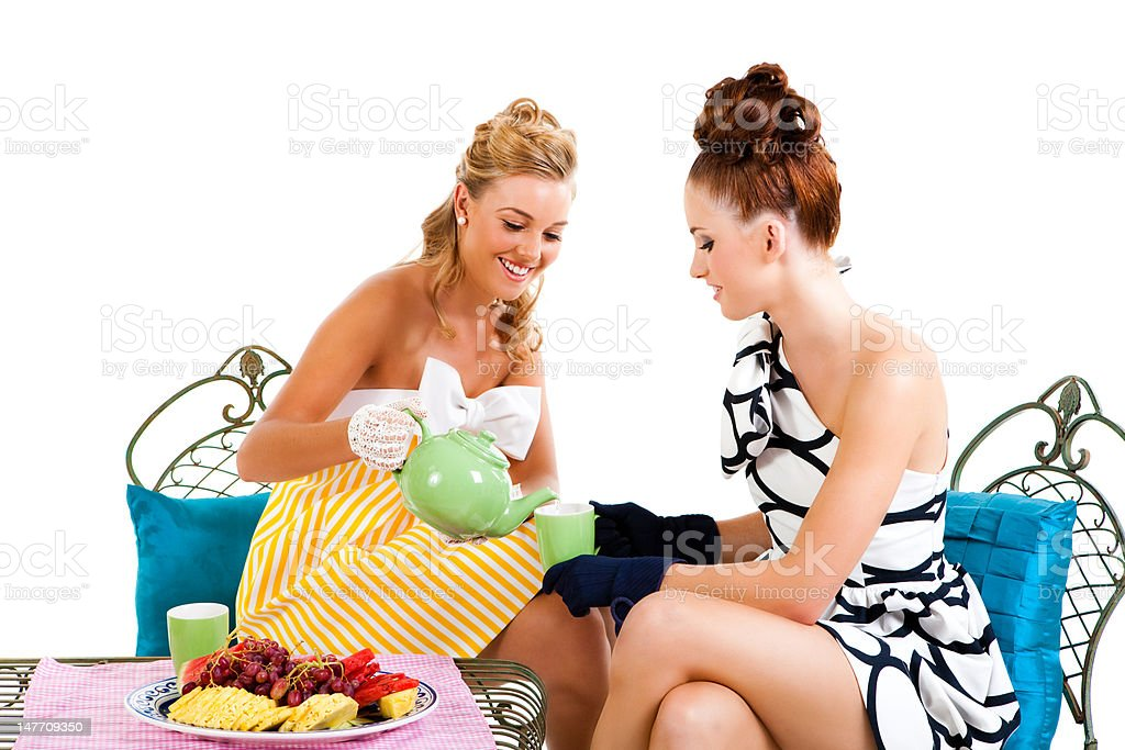 Two Young Women Having Tea - Isolated royalty-free stock photo