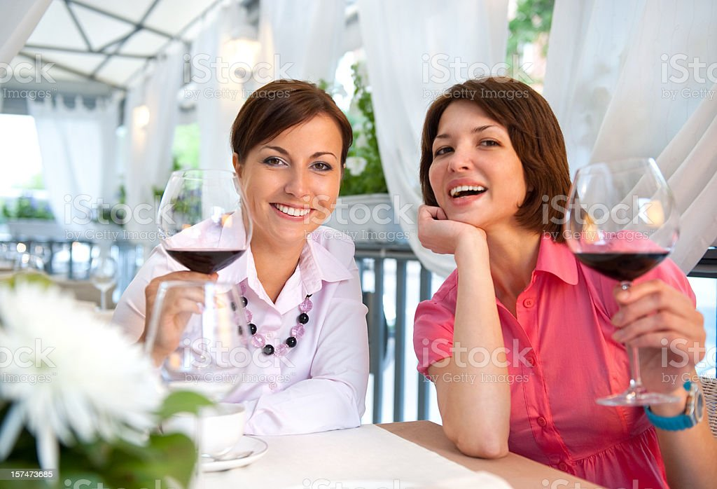 Two young women in a restaurant royalty-free stock photo