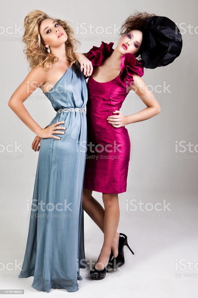 Two Young Women in Avant Garde Attire royalty-free stock photo