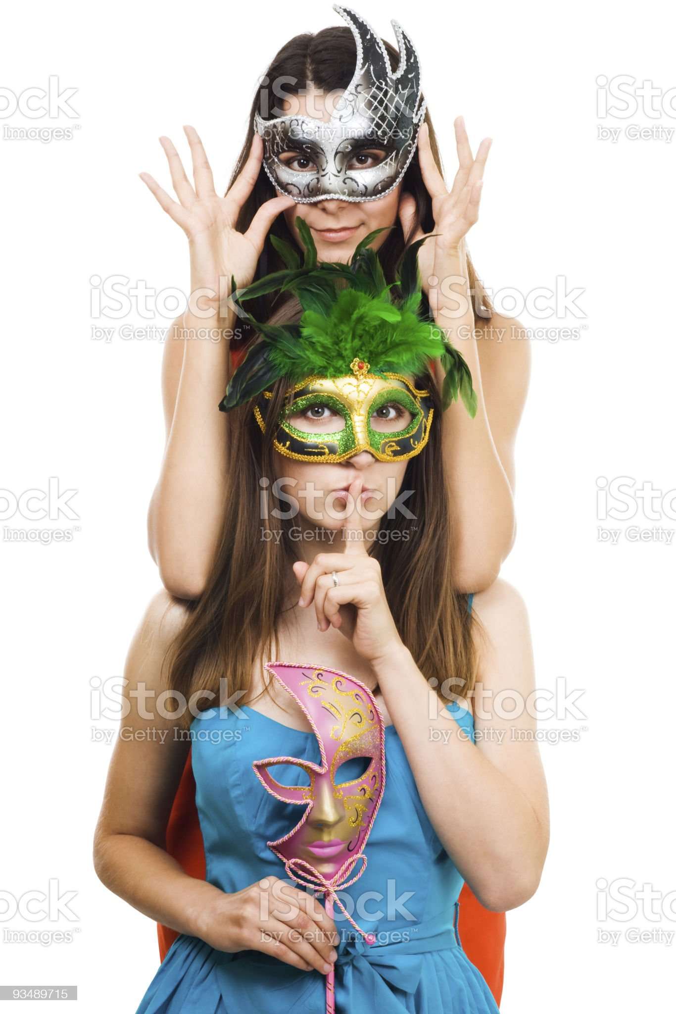 Two young women in masks make hush sign royalty-free stock photo