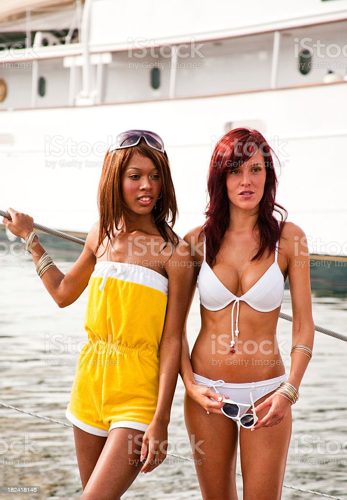 Two Young Women Modeling Swimwear royalty-free stock photo