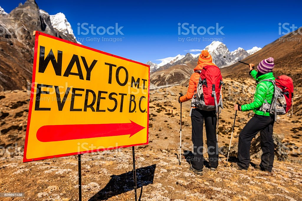 Two young women on the way to Everest Base Camp stock photo
