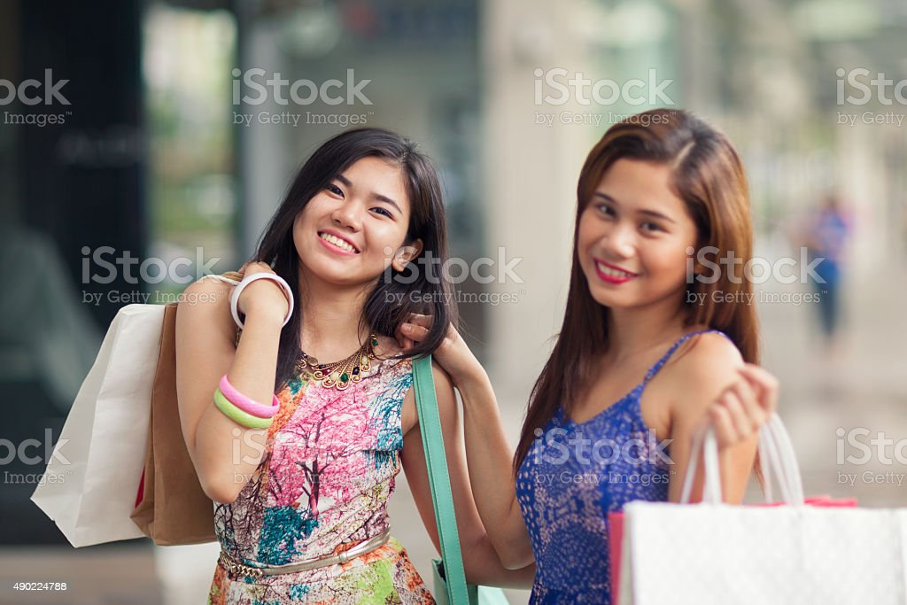 Two young women out shopping stock photo