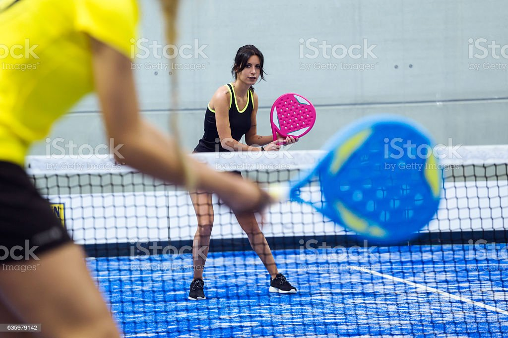 Two young women playing paddle tennis. stock photo