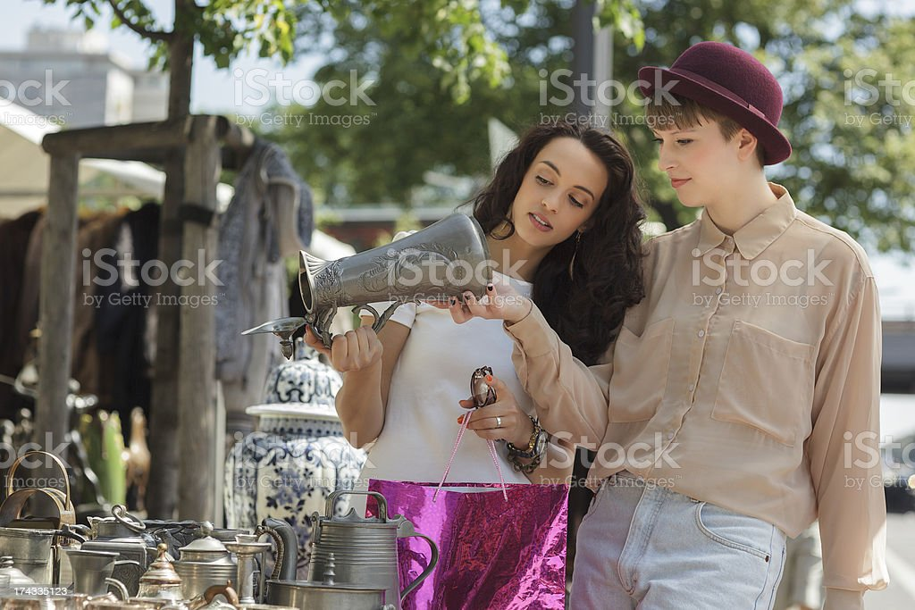 Two young women shopping at Berlin Sunday flea market stock photo