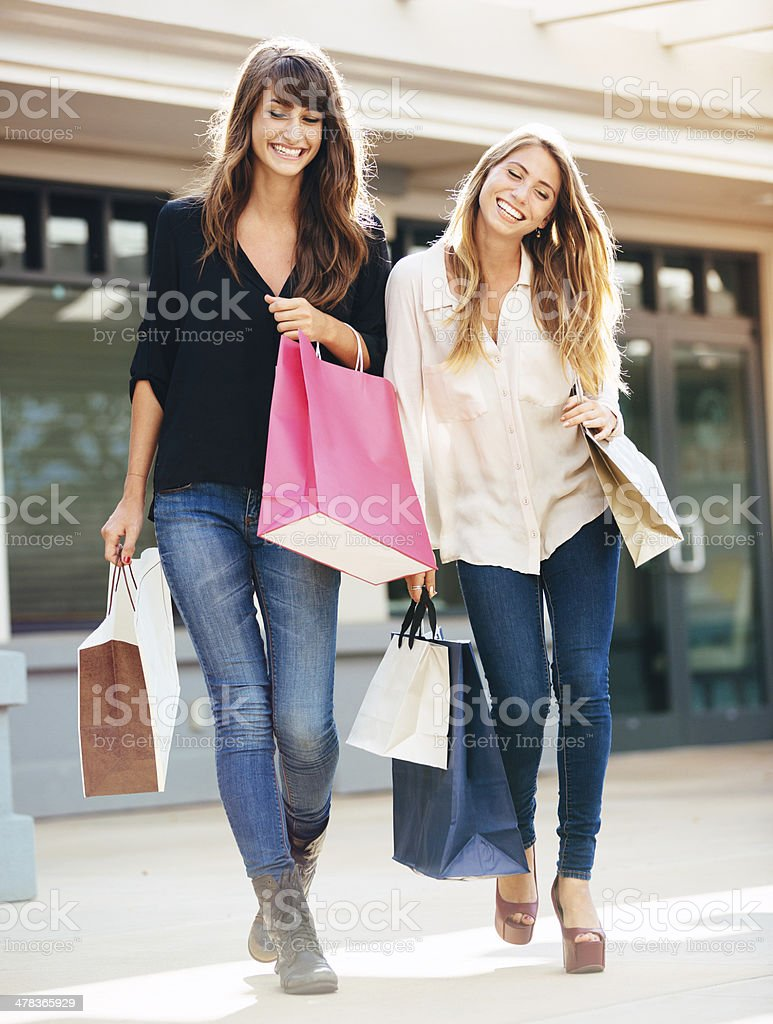 Two young women shopping at the mall stock photo