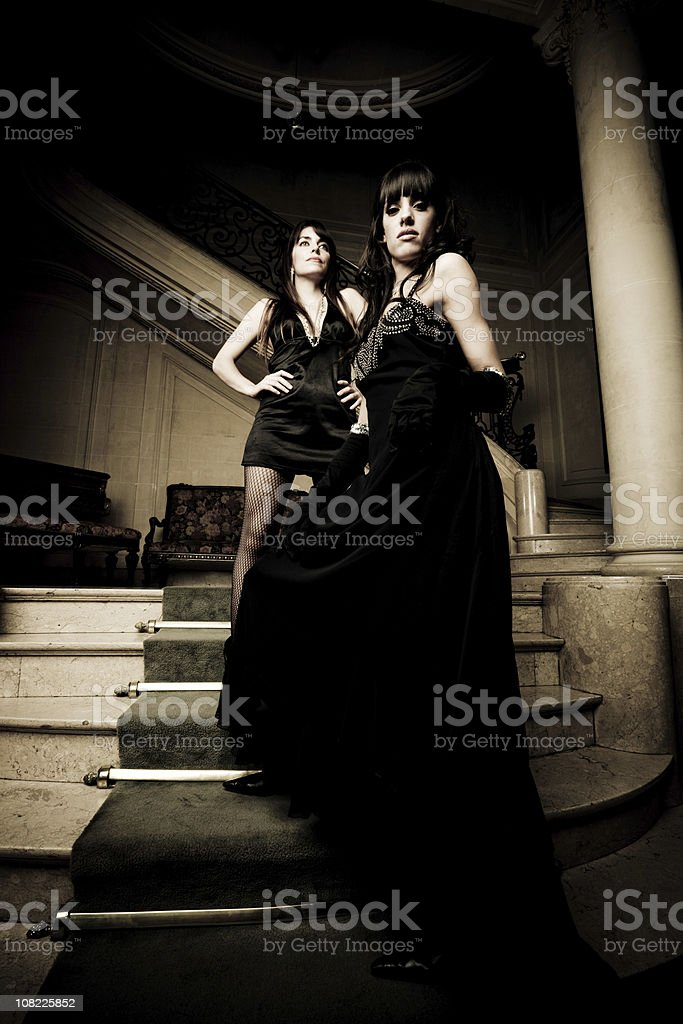 Two Young Women Standing on Staircase royalty-free stock photo