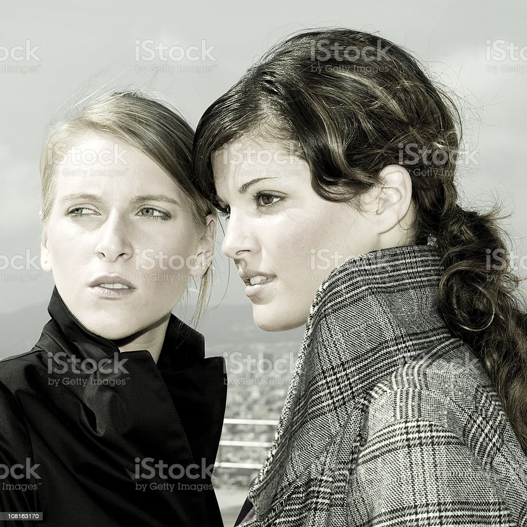 Two Young Women Staring to the Left royalty-free stock photo