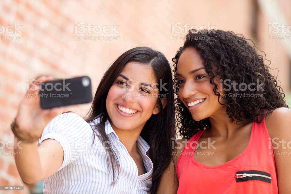 Two Young Women Taking a Photo stock photo