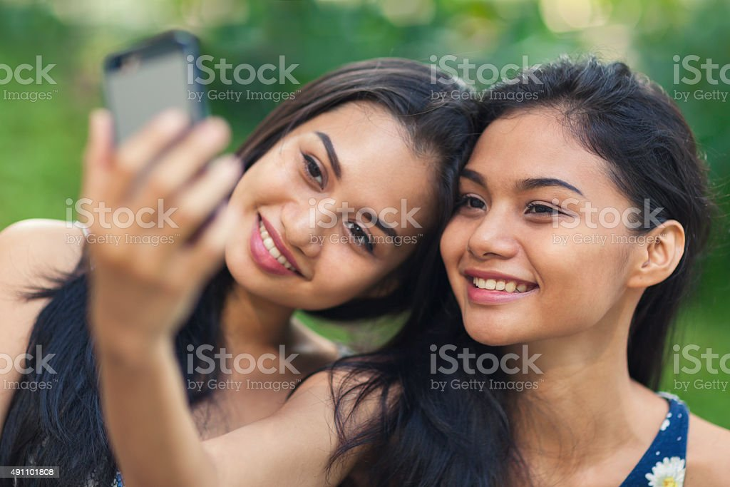 Two young women taking a selfie stock photo