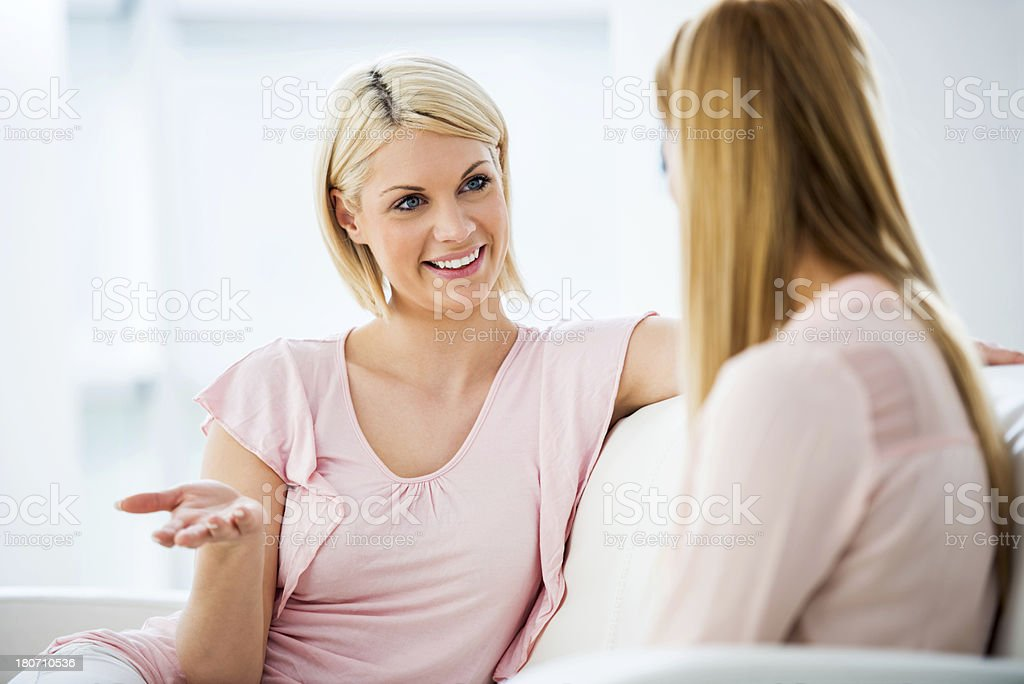 Two young women talking royalty-free stock photo