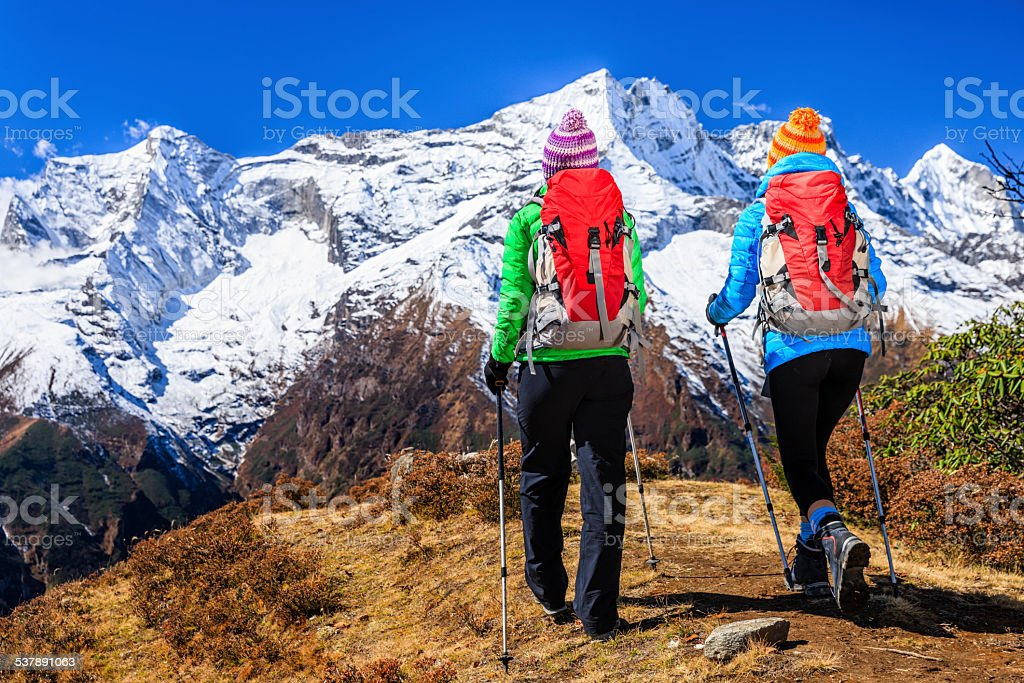 Two young women trekking in Himalayas, Mount Everest National Park stock photo