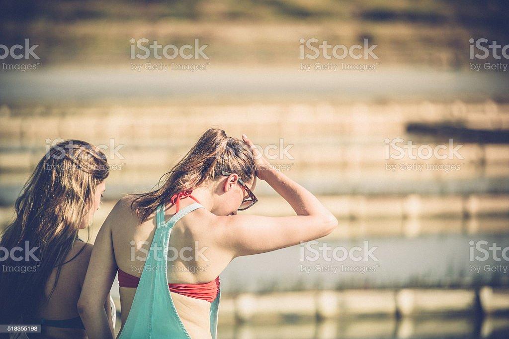 Two young Women walking at Seaside stock photo