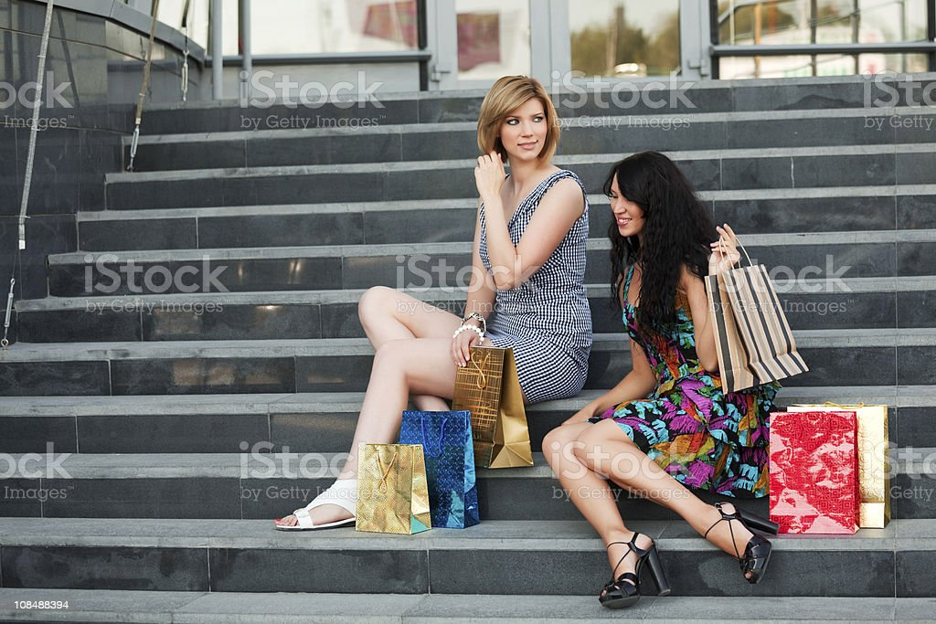 Two young women with shopping bags royalty-free stock photo