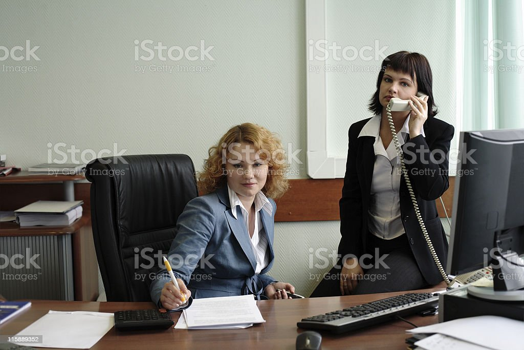 two young women working in office royalty-free stock photo