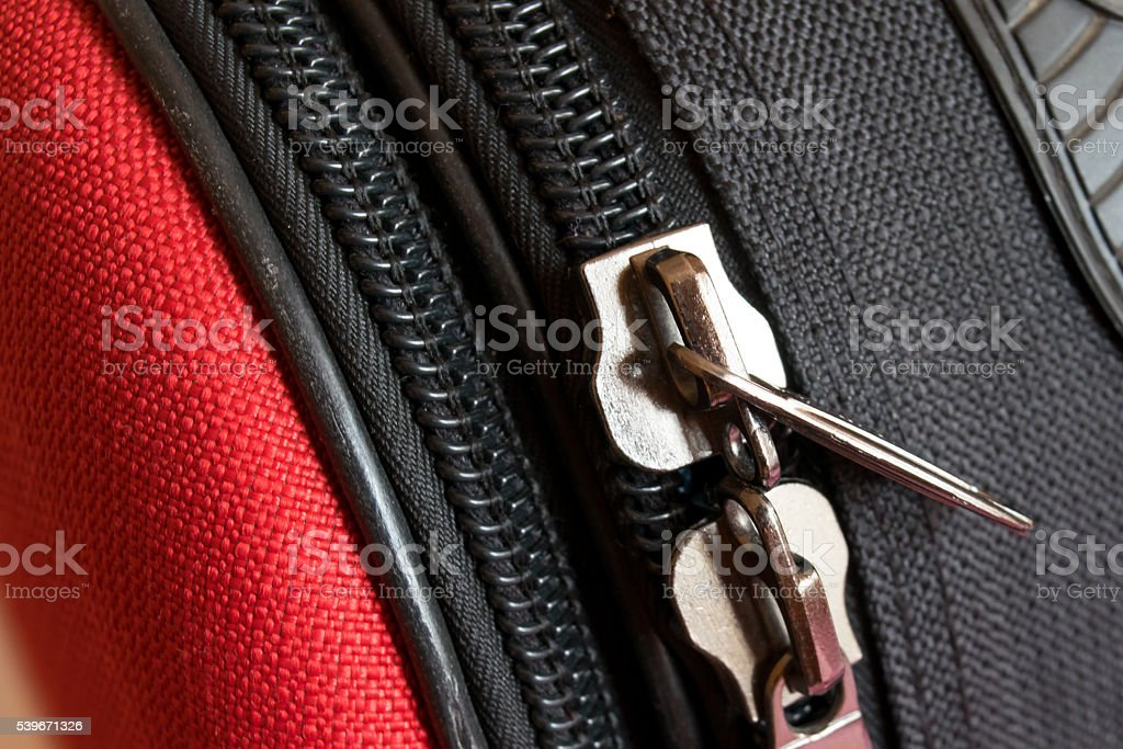 two zipper on red and black luggage back stock photo