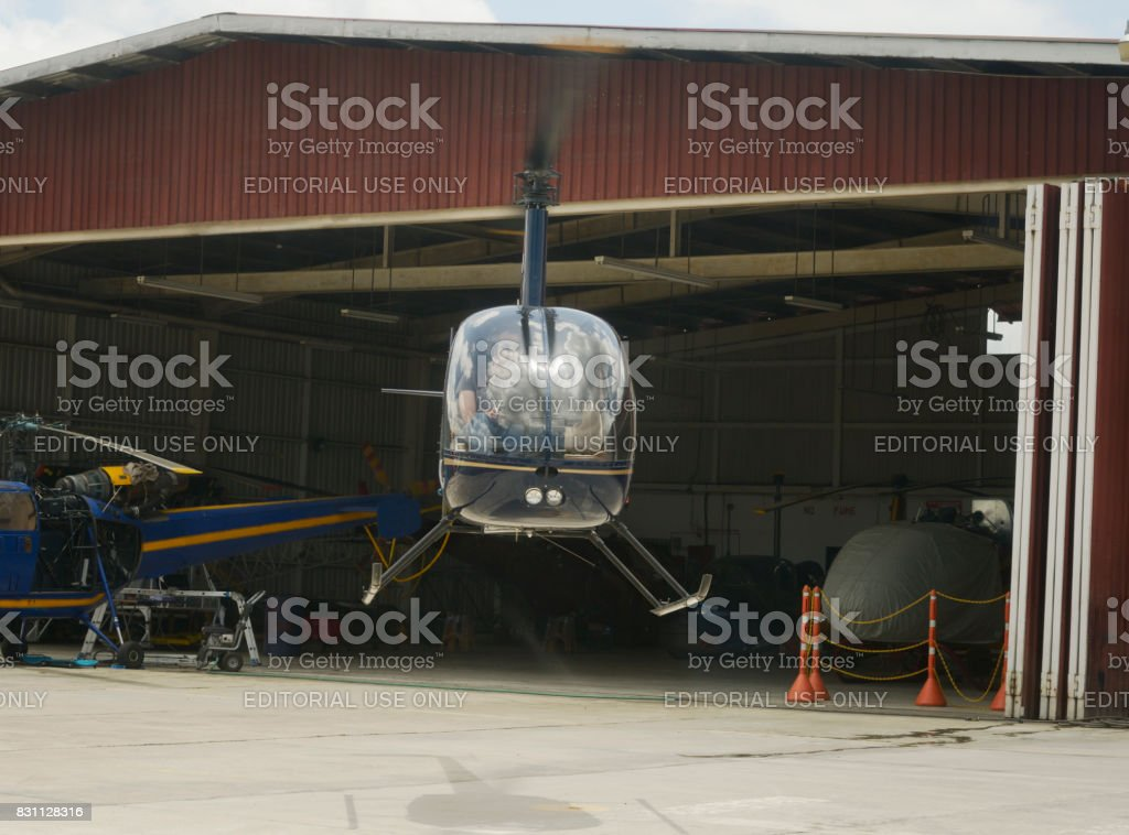 Two-bladed, single-engine light utility helicopter landing stock photo