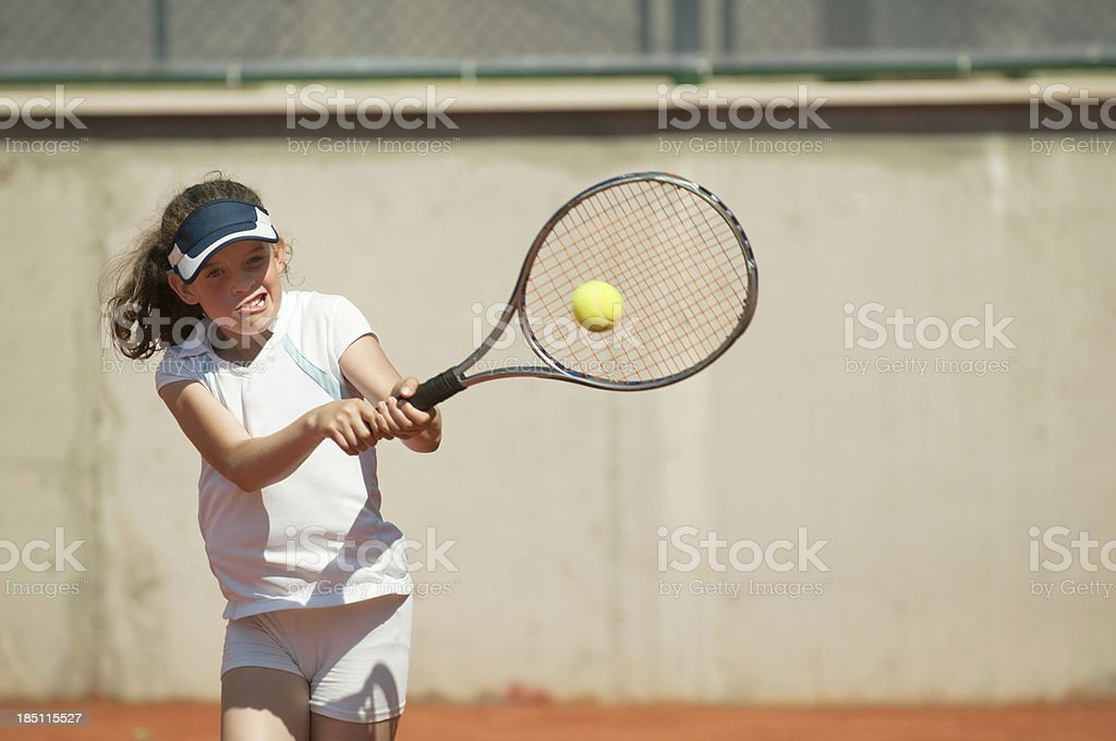 Two-handed backhand stroke royalty-free stock photo