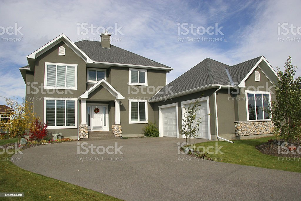 Two-story estate house with long driveway stock photo