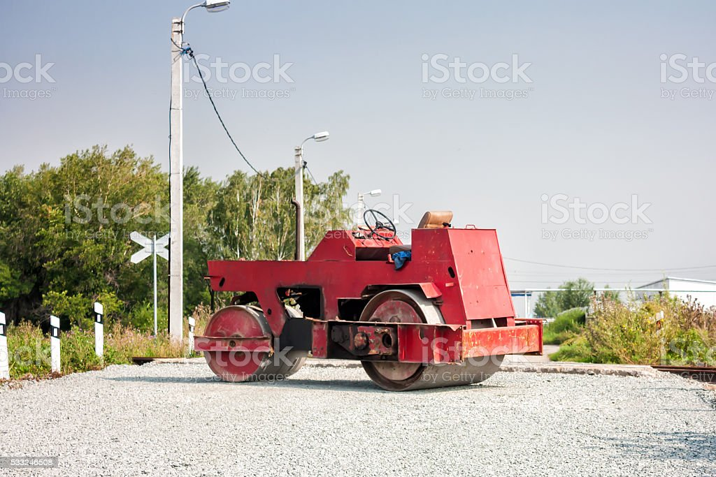 Two-wheel tandem roller at railway crossing royalty-free stock photo