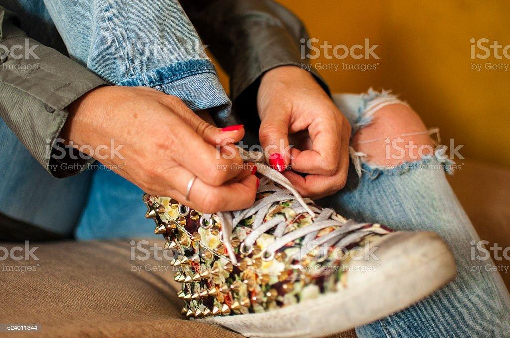 Tying a shoe stock photo